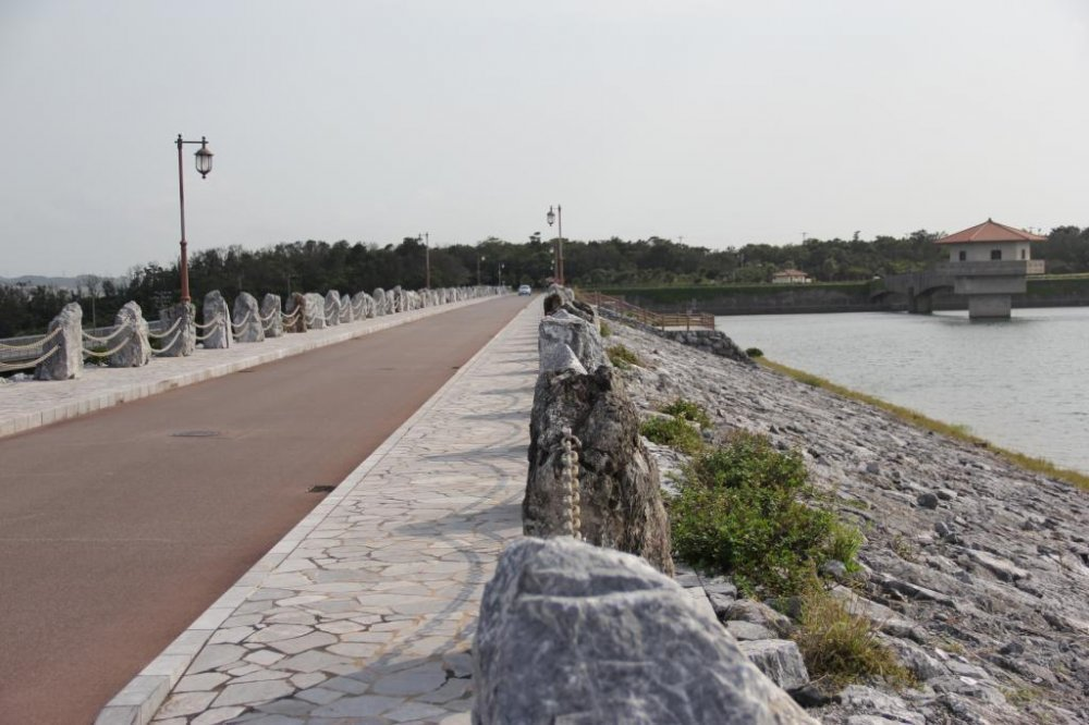 The road across Kurashiki Dam is picturesque along both sides and each end