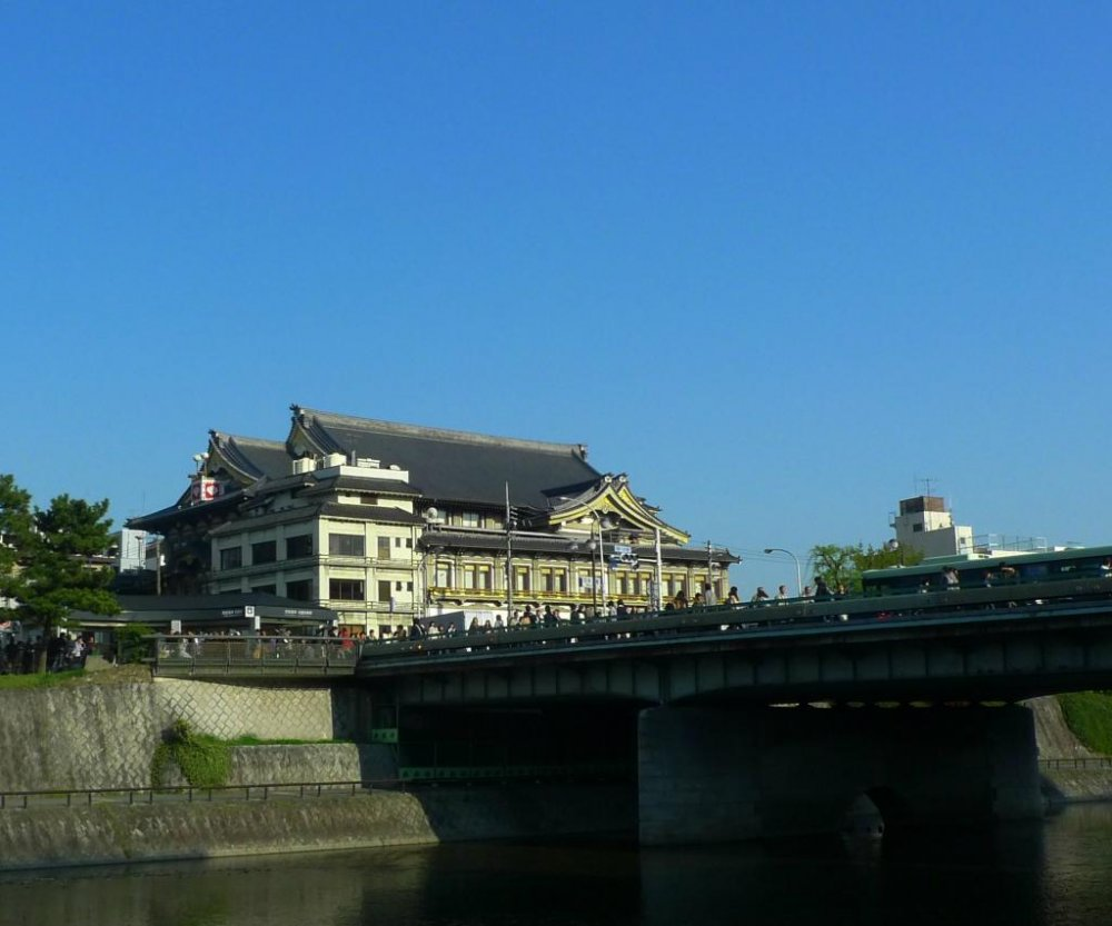View of Minamiza Kabuki theater from the Kamo River.