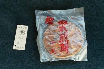 An old fashion ticket and Nure senbei, wet or moist senbei