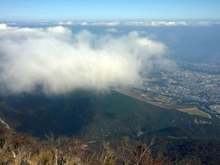 On one side lies the city of Beppu and the sea