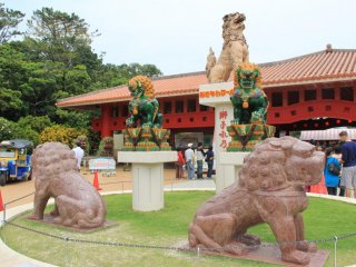 Shisa dogs at the entrance of Okinawa World demand that visitors walk around them to gain entrance to the park