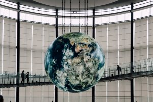 A huge globe hangs between levels 3 and 5 showing a week's worth of satellite and weather data.