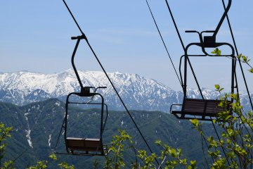 Ski lifts viewed from the ropeway. The region is a popular winter sport destination