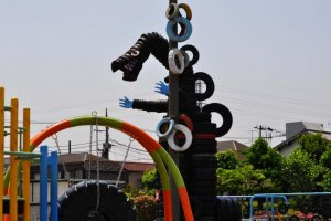 Godzilla reigning over the playground