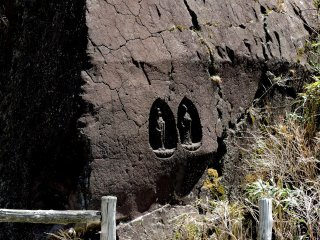 Buddhist statues carved into a large rock