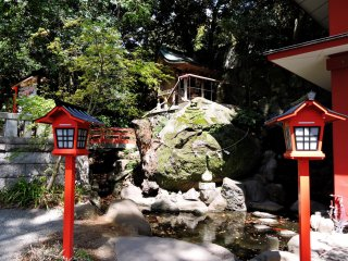 Small shrine overlooking a koi pond