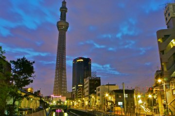 <p>Evening time: Beautiful Tokyo Skytree partially reflecting in the waters below, just before light-up time</p>