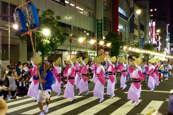 Local and Tokushima teams perform the exuberant dance moves