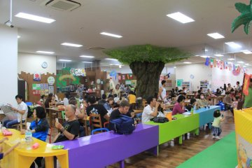 <p>There are dozens of tables and benches for parents and children to rest or enjoy a snack at</p>