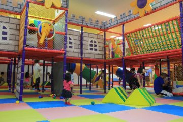 <p>There is one toddler play area and three larger play areas like this one that each have an open center court surrounded by various play stations and topped by a second level of catwalks full of surprises</p>
