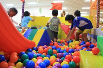 <p>Kids love to mix it up off of a slide into a ball pit surrounded by foam barriers and netting</p>