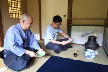 Performing a tea ceremony with guests