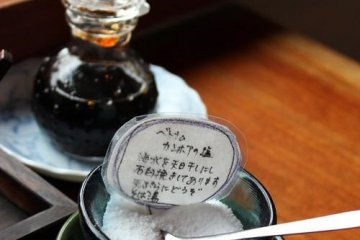 <p>Salt and soy sauce for tempura on the table</p>