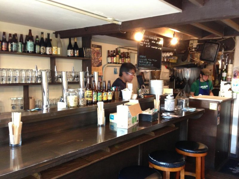 Staff prepare to open the bar early for a monthly event