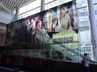 Big Gatsby movie poster on glass that separates the lobby of Toho Cinemas.