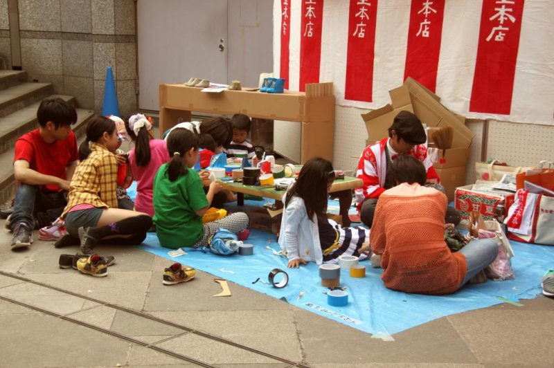 Shoe-making with recycled materials and tape - the most popular workshop with children in the gallery area.