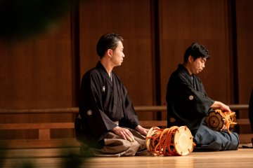 Noh musicians show how to play the drums