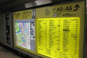 Bright yellow maps are available in English and Japanese.
