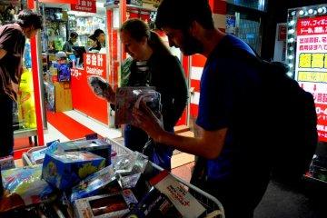 Shoppers peruse an assortment of merchandise