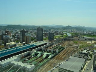 The east side of Morioka Station with mountains behind.