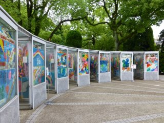 There are nine 'booths' surrounding the statue, each one housing thousands of paper cranes
