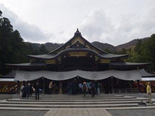 The shrine is flanked by mountains and cedar trees