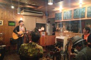 Acoustic artist performing at J-Lodge