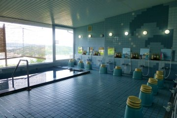 A communal hot bath (onsen) is located on the first floor
