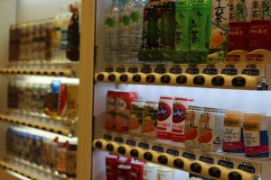 A host of vending machines providing a variety of beverages to quench your thirst.