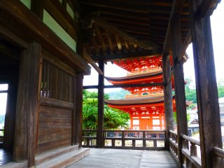 The bright red of the Five Story Pagoda peeks through the hall