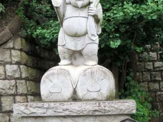 Daikokuten, a god from India, who stands for prosperity, especially in the kitchen