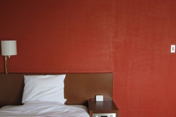 Scarlet red wall makes a good backdrop to the room