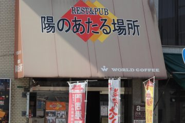 The restaurant sign seen from the station