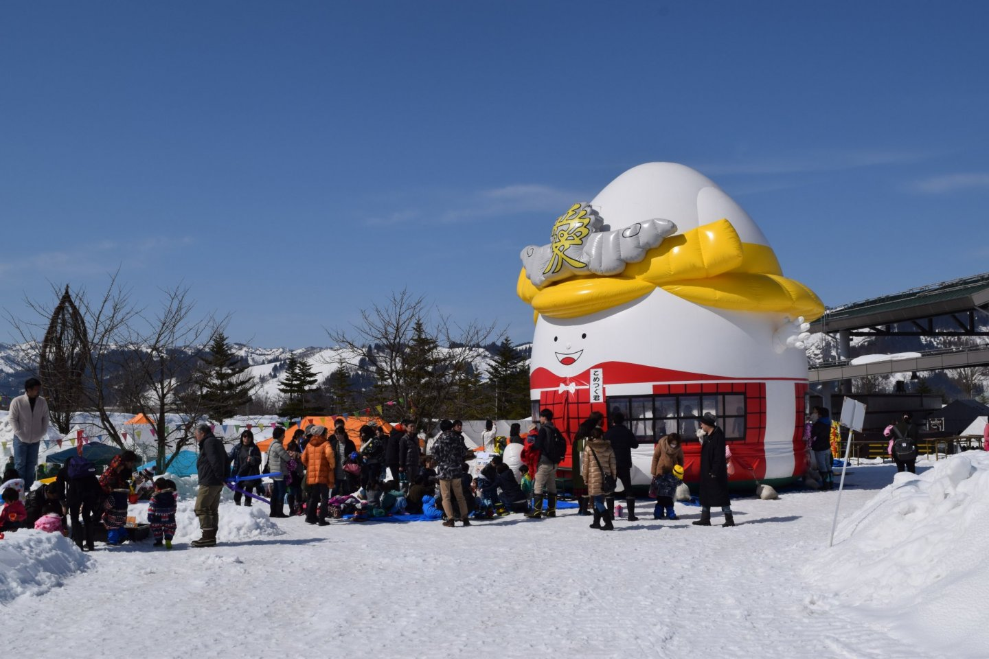 A bouncy house in the snow for kids to enjoy