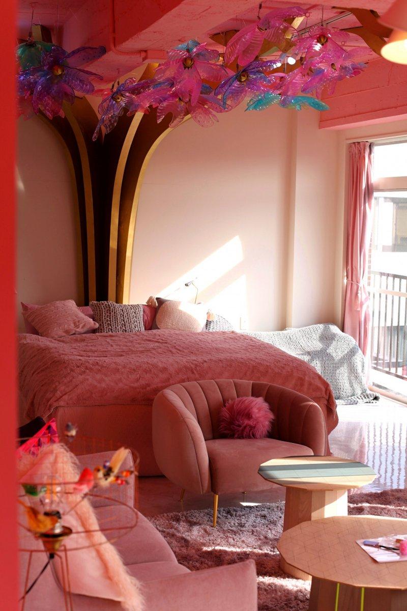 Plush luxury bed with dramatic sakura installation