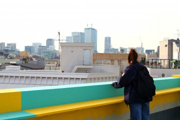 Bright roof terrace with views out across Tokyo