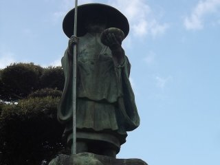 This pilgrim looks down from a high pedestal