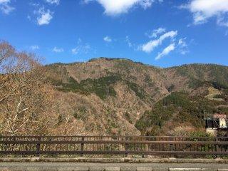 Myojogatake (elevation 924 meters) as seen from a bridge in the town