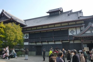 Cast pose for photos with visitors in front of the Ninja Theatre