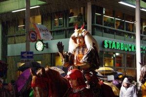 Shingen Takeda riding past Starbucks