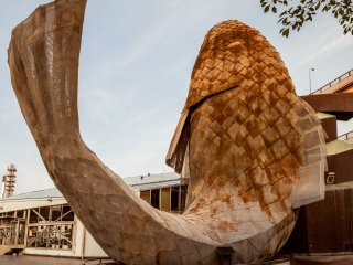 This giant mesh fish stands out the front of Cafe Fish! and depicts a dancing carp, designed by Frank O. Gehry.