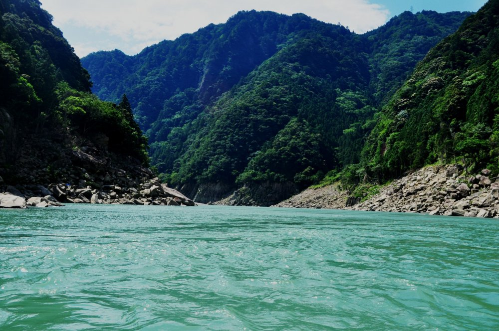 The water of the Kumano River is incredibly clear and blue