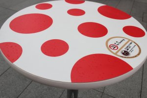 Of course the tables are even covered in red polka dots.