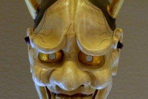 A hannya demon mask of the kind worn in plays like Dojoji