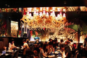 Dine under a spectacular chandelier at Alice's Fantasy Restaurant in Shinjuku.