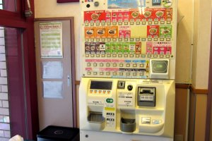 A ticket machine where you choose your meal and to pay