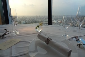 Crisp, clean table setting overlooking the city