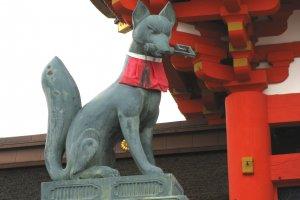 Kitsune holding a rice storage key