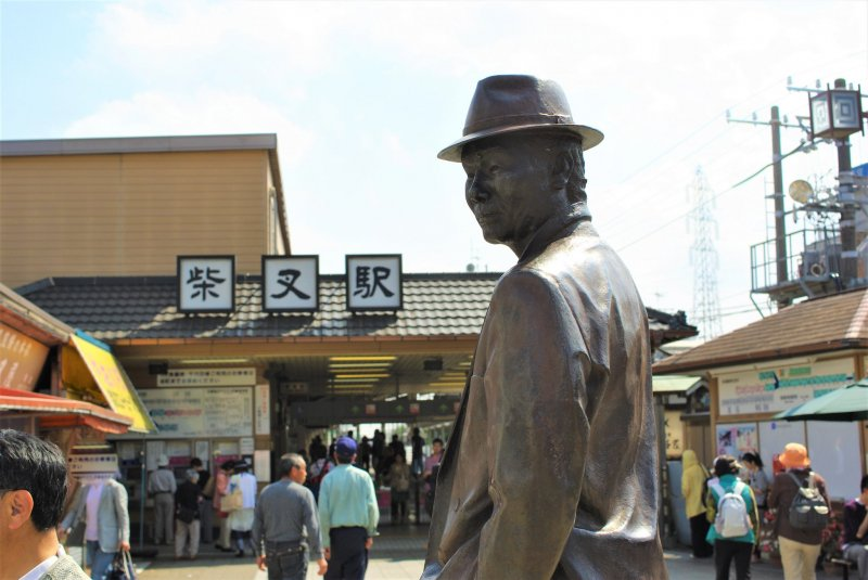 A statue of Tora-san greets visitors as they leave Shibamata Station