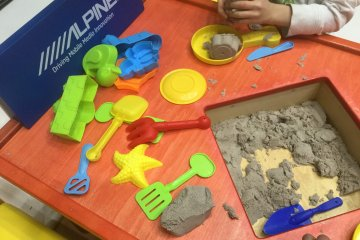 Sand table to keep little hands busy.